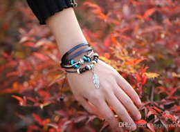Men and women with the kind of pure handmade leaf pendant leather bracelet head layer cowhide leather cord bracelet alloy