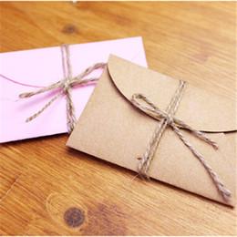 Papelería sobre de papel en venta-Mini papel hecho a mano del sobre del papel del arte de la venta al por mayor-50pcs / lot 9 * 5.8cm Brown y bolso de papel rosado Sobres de la vendimia Conjunto de los efectos de escritorio