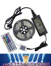 Wholesale La tira más barata los M flexibles del RGB LED de la venta al por menor los ft SMD los M LED impermeables con el regulador alejado y la fuente de alimentación MYY