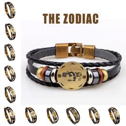 Bracelets faits main de signe de zodiaque pour les femmes Hommes Bracelet en cuir véritable Bracelet en bois + Bijoux de charme Gallstone noir 12 pcs / ensemble Vente en gros supplier handmade wooden bracelets à partir de bracelets en bois faits à la main fournisseurs