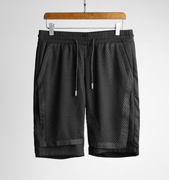 Handsome men's shorts ~ hollow mesh stitching fabric ~ tide men's leisure gym shorts