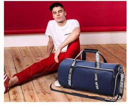 Ha lang new cylinder gym bag male overnight bag female hand luggage bag package of fitness Duffel Bags
