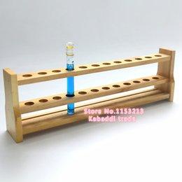 Promotion trous bois Grossiste en bois rack tube colorimétrique 100ml * 12 trous bois épais bois tube rack Fabricants d'exportation de laboratoire Diamètre du trou 30mm