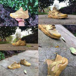 La conception de chaussures de couleur en Ligne-Nouvelle conception de couleur or Chaussures de course à air Huarache 4 pour hommes Femmes Top Sneakers Sport sportif Chaussures de sport Huaraches Taille: 36-46