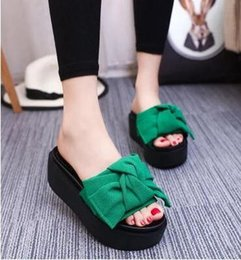 The summer of beautiful new Korean muffin heels lady slope with bow shaped outdoor sandals shoes