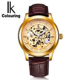 Promotion cru mens watch automatique IK Coloriage Vintage Gold Hollow Skeleton Watch Hommes Cas en acier Ceinture en cuir véritable Montres mécaniques automatiques Style imperméable à l'eau
