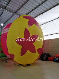 Ace Air Art Offered 2.2m H Yellow Giant Inflatable Easter Eggs with Leaves for Easter Party in the USA