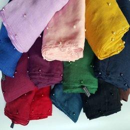 New Colorful Pearls Echarpe Plaine Hijabs Pour Femmes Viscose Solid Shawl Nice Beads Écharpe Musulmane Enrouleur Enceinte Écharpes Mode Fantaisie FS1019 à partir de perle solide fournisseurs