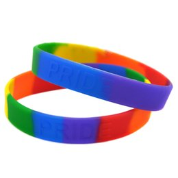 Wholesale 100PCS Lot Rainbow Colour Pride Silicone Bracelet Embossed Logo Wristband Women and Men Gift Jewelry