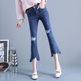 Summer tassel hole flared jeans female Korean elastic thin irregular flared trouser pants pants seven