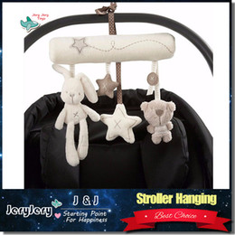 Wholesale Rabbit baby music hanging bed safety seat plush toy Bunny Hand Bell Multifunctional Plush Toy Stroller Mobile Gifts
