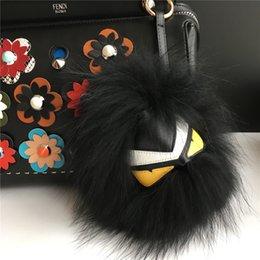 Wholesale 1 piece cm quot Black Fur Yellow eyes Fluffy Furry Genuine Fox Fur Monster Bugs Charm Fur Ball Pom pon Bag Car Keychain Charm Pendant