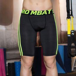 Descuento capas base La venta al por mayor-Hombre pone en cortocircuito de la capa de la base de los deportes de la aptitud de los pantalones cortos de la aptitud de los cortocircuitos de los cortocircuitos de los hombres