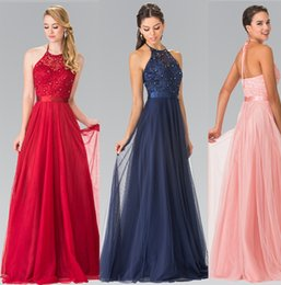 halter embroidered long prom evening dresses with with sparkling beads Sash adorns the waist atop a tulle floor length skirt