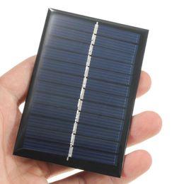 Оптово-4шт 6V 0.6W Solar Power Panel Poly модуль DIY Малый сотовый зарядное устройство для батареи телефона Свет игрушки Портативный от Производители панели солнечных ячеек оптового