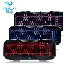 AULA SI-859 retroiluminada teclado de juegos con luz de fondo ajustable Rojo púrpura azul USB con cable iluminado teclado de computadora para juego desde teclado para juegos de luz de fondo azul proveedores