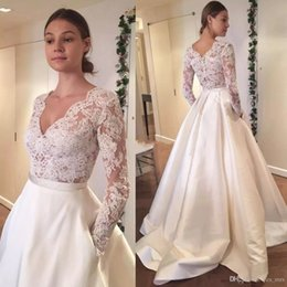 2017 A Line Wedding Dresses V Neck Illusion Lace Appliques Long Sleeves Sheer Back Sweep Train Bridal Gowns