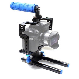 Compra Online Aparejo de jaula-2015 Nueva cámara C7 Cámara Cage DSLR cámara con Top Handle Grip + Rail cabeza para Panasonic Lumix GH3 GH4 cámara Rig