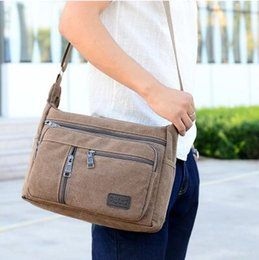Men and women on the new han edition recreational canvas shoulder bag, oblique ku chest pockets