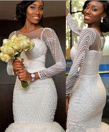 2018 New African Wedding Dresses Mermaid Jewel Neck Long Sleeves Crystal Beaded Pearls Bridal Dresses Sweep Train Custom Formal Bridal Gowns