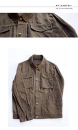 Aceite de cera de tela hombres chaqueta AMI de color caqui japoneses retro viejo bolsillo de decoración de la juventud desde chaquetas de los hombres de cera fabricantes
