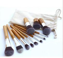 Descuento conjunto de maquillaje cepillo de bajo precio Caliente Maquillaje cepillo 11 cepillo de maquillaje cepillo de maquillaje de bambú manija de la manija con el punto de la bolsa de lino al por mayor precio ultrabajo