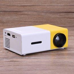 Descuento el jugador del sd para la televisión Venta al por mayor- YG300 proyector LCD 600LM Home Media Player MINI proyector para videojuegos TV Home Theater película de apoyo HDMI AV SD