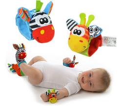 Promotion chaussettes lamaze hochet 10set Le nouveau bébé de findzy de bruit d'application d'apparcheur de pied de bébé joue les chaussettes et les bracelets de hochet de bébé de Lamaze de chaussettes de tracteur de bébé libèrent l'expédition