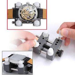 Descuento relojes de los hombres titular Venta al por mayor-Portátil útil Watchmaker Mans Watch herramienta de reparación de la espalda titular del caso Adjustable Remover WT01