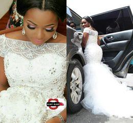 Wholesale Plus Size Arabic Nigerian Wedding Dresses Luxury Beading Pearls Sheer Bateau Neck Short Sleeves Chapel Train Tulle Mermaid Bridal Gowns