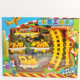 Wholesale Children s electric rails car toy set track pig City Guard small train bulldozers etc