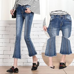 The new high waisted jeans BDF female Korean spring thin slim flash horn nine pants denim baggy pants