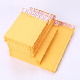 Compra Online Burbuja de papel kraft-12 * 18cm (4,72 * 7,09 pulgadas) Paquete polivinílico del regalo del bolso de envío del sobre del cojín del envío del papel del arte del cartero del sobre de la burbuja de 100Pcs nuevo