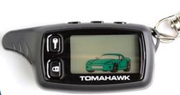 Descuento sistema de alarma a distancia un coche Sistema de alarma bidireccional TOMAHAWK TW9010 del coche de la alarma del coche de la alarma TOMAHAWK TW9010 LCD del coche Sistema de alarma dual TOMAHAWK TW9010 Keychain del coche de la manera