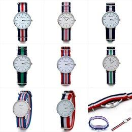 La venta CALIENTE 2017 relojes de nylon de las rayas de la alta calidad mira los hombres ocasionales y los relojes de las mujeres Europa y la tabla de la manera de la joyería de Estados Unidos mejor desde mejores relojes de moda de calidad fabricantes