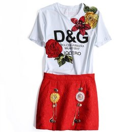 Wholesale The new Europe and the United States women s spring Heavy industry rose sequined flower T shirt heavy miniskirt two suits