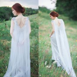 Romantic Fairy Wedding Dress A Line Bohemian Open Back Bridal Gowns Sheer Bateau Beaded Neckline Flowing Train Vintage Beach Wedding Dress