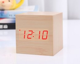 Cajas de madera relojes en Línea-Nuevo control de acústico de madera creativo del reloj del estilo LED del estilo que detecta el reloj con el envío libre de la caja de papel de Batttery Envío libre