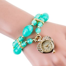 Montres de gros perle à vendre-Livraison gratuite en gros FashionableHan édition perles bracelet en cristal montres Femme table set torche mode gros dames haut de gamme wa