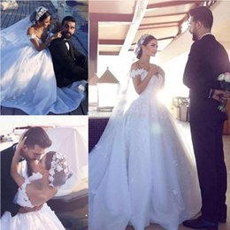 2017 Ball Gown Weddding Dresses Off Shoulder Floral Appliques Tulle Organza Backless Chapel Arabic Bridal Wedding Gowns Dubai