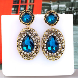 European and American high-end atmosphere beautiful girl fan color gold with diamond earrings drop type female alloy jewelry wholesale