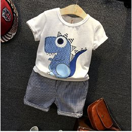 Children's clothing 2017 new boys summer and summer dinosaur short T + cotton and linen striped shorts suit