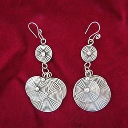 Guizhou ethnic minority wind retro earrings earrings handmade Miao silver jade face pieces earrings