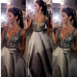 Stunning Beaded Crystals Sexy Plunging V Neck Prom Dresses Long Formal Backless Evening Party Gowns Floor Length Sleeveless Formal Wear