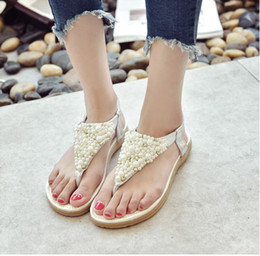New summer 2017 han edition student rhinestone beaded sandals women sweet pearl flat princess Roman shoes pinch