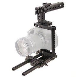 2017 aparejo de jaula Cámara Cage Rig w / Top Handle Placa de montaje en trípode fr Canon Nikon Sony Panasonnic aparejo de jaula oferta