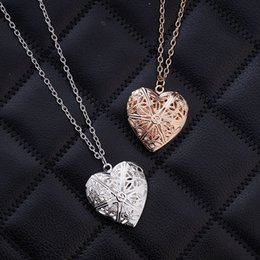 Wholesale EBay aliexpress hot models of love can put photos of DIY hollow pendant pendant necklace lovers