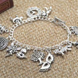12pcs Labyrinth inspired bracelet Lancelot the bear Clock Merlin the dog Fairy Worm charm bracelet