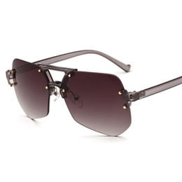 7627410fb224d2 lunettes de soleil fourmi sans monture lentille irrégulière protection UV lunettes  de soleil lunettes de soleil pour femmes et hommes gris sans cadre gris ...