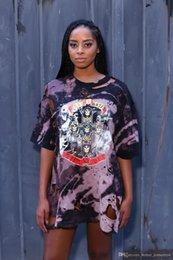 European Suit-dress U.S.A Rock Section Explosive Printing Irregular Holes Robe Femme adulte Polyester Casual Cap Robe manches courtes pas cher à partir de mini-roches fabricateur
